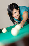 Lady playing billiard Stock Photography
