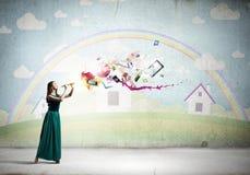 Lady playing fife Stock Image