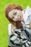 Lady playing. And golf swing with smile Stock Images