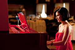 Lady playing the piano Stock Photo