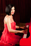 Lady playing the piano Royalty Free Stock Photo