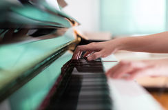 Lady playing piano Stock Photos