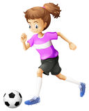 A lady playing soccer Stock Images