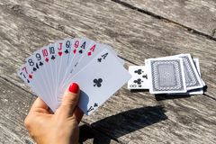 The lady plays cards. Women hand holding cards for play Royalty Free Stock Photos