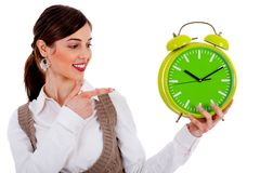Lady pointing at alarm clock Stock Photo