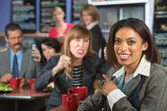 Lady Pointing at Angry Person Stock Photo