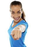 Lady pointing her finger towards the camera Royalty Free Stock Image