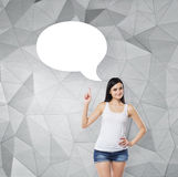 Lady is pointing out the empty thought bubble. Contemporary background. Stock Images