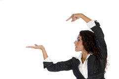 Lady pointing on palm Royalty Free Stock Photos