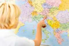 Lady pointing Slovenia on the map of Europe. Stock Photo