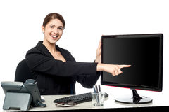 Lady pointing something on computer screen Royalty Free Stock Photography