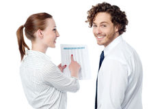 Lady pointing at statistics given on report Royalty Free Stock Image
