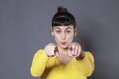 Lady pointing straight at you with both fingers Stock Photo
