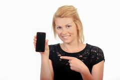 Lady pointing to cellphone royalty free stock photo