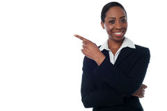 Lady pointing towards copy space area Stock Images