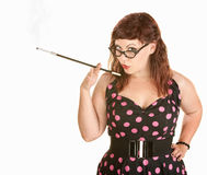 Lady in Polka Dot Dress Smoking Stock Photos