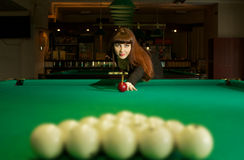 Lady in pool room Stock Photo