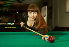 Lady in pool room Royalty Free Stock Photography