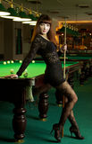 Lady in pool room Stock Image