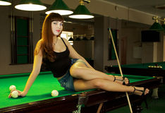 Lady in pool room Royalty Free Stock Photos