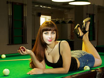 Lady in pool room Royalty Free Stock Photo