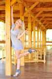 Lady posing near the wooden structure Stock Images