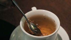Closeup of lady pouring sugar while preparing hot tea cup stock video