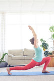 Lady practicing blaster pose with hands up Royalty Free Stock Photos