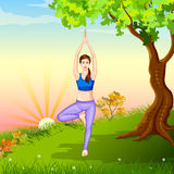 Lady practising yoga for wellness Royalty Free Stock Image