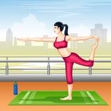 Lady practising yoga for wellness Stock Photo