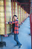 Lady and prayer wheels Stock Photo