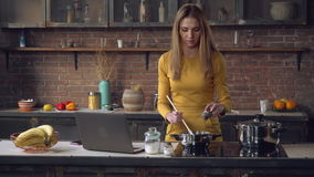Lady preparing dinner at home kitchen stock video footage