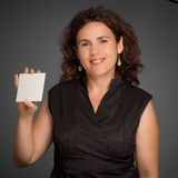 Lady presenting a blank card Stock Photography