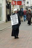Lady promoting Christianity. Wearing sandwich baord in streets of Barnstaple, Devon, England Stock Images
