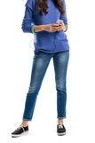 Lady in pullover holds phone. Royalty Free Stock Images