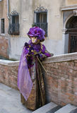 Lady in purple Royalty Free Stock Image