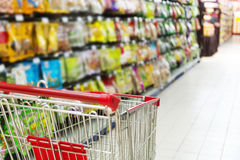 Lady pushing a shopping cart Stock Photos