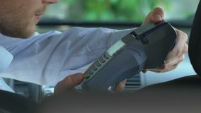 Lady putting bank card to payment terminal making easy transaction for taxi ride. Stock footage stock footage
