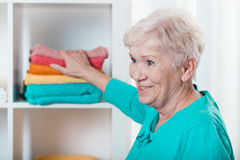 Lady putting towels Stock Image