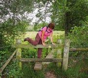 Lady Rambler climbing over a Stile Stock Photos