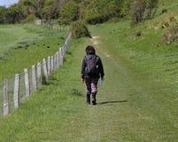 Lady Rambler on a grassy Trail Royalty Free Stock Photo