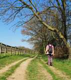 Lady Rambler on a Rural Trail Royalty Free Stock Photography