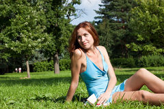Lady reading the book in grass Royalty Free Stock Photography