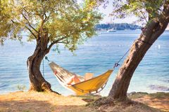 Lady reading book in hammock. Royalty Free Stock Photography