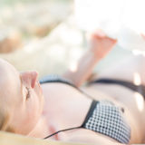 Lady reading a book in a hammock. Royalty Free Stock Photography