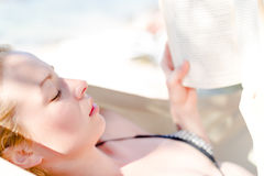 Lady reading book in hammock. Stock Image