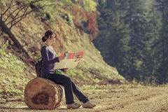 Lady reading travel map Royalty Free Stock Image