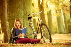 Free Lady Reading Under Tree. Stock Photo - 93196660