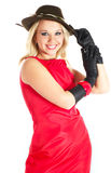 Lady in red. Elegance young woman in red gown in bonnet and gloves Royalty Free Stock Photos