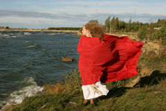 Lady in red. On windy day near  the sea Stock Images